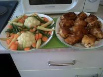 Fried chicken cutlets and fresh steamed vegetables